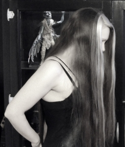 In Black and white, behind the hair.
