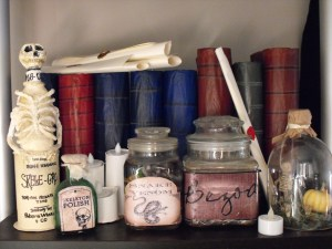 DIY Halloween party Harry Potter theme Skele-grow magic potion bottle prop and potion ingredients display.